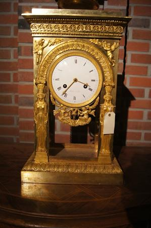 Bronze gilded empire clock
