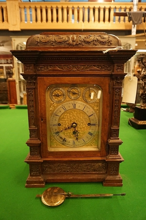 Oak table clock with 8 bells and 5 gongs, around 1900