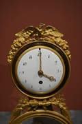 Directoire style Clock in gilded bronze and marble, France last part 18th C.