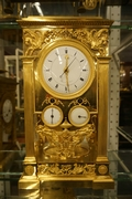 Empire style Calender Clock in gilded bronze, France around 1800