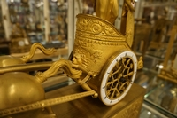 Empire style Chariot clock in gilded bronze, France around 1800
