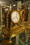 Empire style Clock in gilded bronze, France around 1800