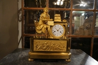 Empire style clock in gilded bronze, France 18th century