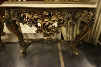 Mirror top console table in gilded wood, Italy first half 20th C.