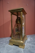 Table clock in Glass and gilded bronze , France 19th C.